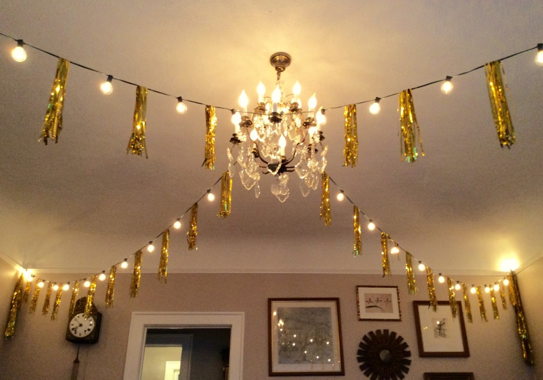Two strings of lights with gold tinsel created a fun vibe to the living room.