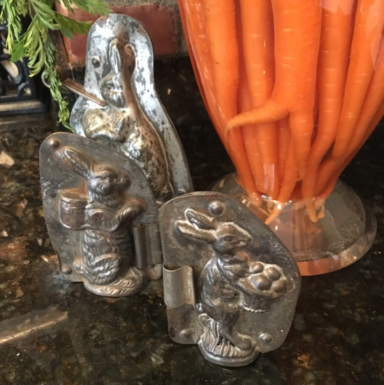 Carrots in apothocary jar w antique chocolate molds